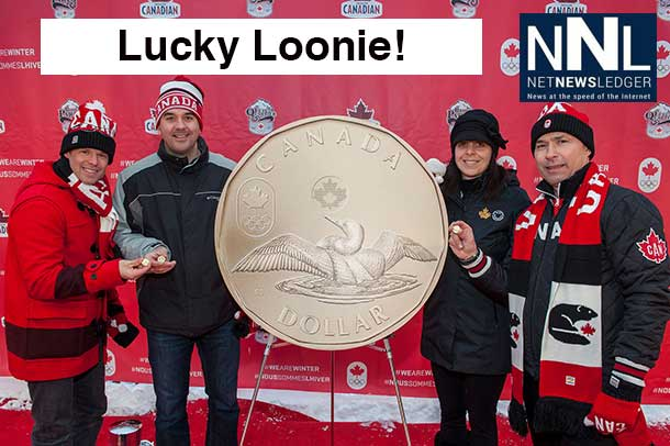 Jean-Luc Brassard, Assistant Chef de Mission, Blake Richards, MP for Wild Rose, Christine Aquino, Director of Communications and Public Affairs at the Royal Canadian Mint and Steve Podborski, Sochi 2014 Chef de Mission unveil the 2014 Lucky Loonie circulation coin at the Canadian Olympic Team's Sochi Block Party event in Banff, Alberta