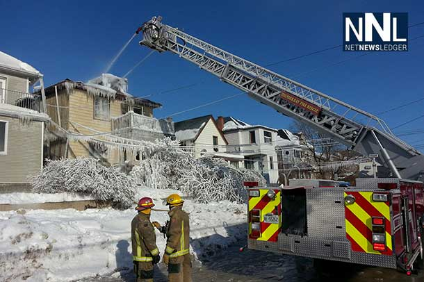 Thunder Bay Fire Rescue Crews on scene with aerial ladder to ensure fire is out.