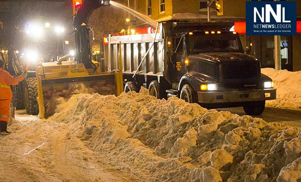Snowbanks have to be ploughed out into the street and then huge snowblowers remove the snow into dump trucks.