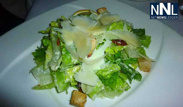 Bistro's Caesar Salad with Bacon, Seasoned Croutons and Shaved Parmeggiano