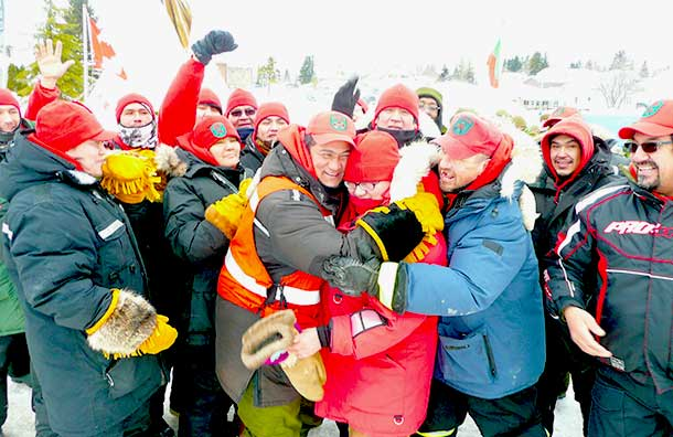 Canadian Rangers celebrate their patrol's arrival in Cochrane, Ont., to open the town's winter carnival. Photo Sergeant Peter Moon.
