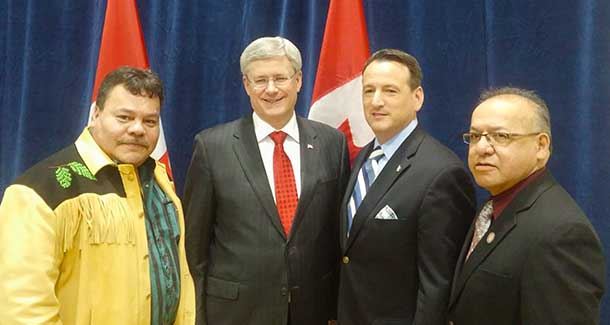 Grand Chief White of Treaty 3Prime Minister Harper with Minister Greg Rickford, Nishnawbe Aski Chief Harvey Yesno.