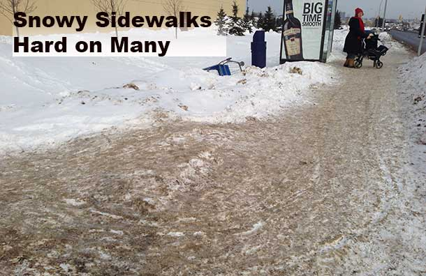 The snow has built up along sidewalks making it very difficult for mobility challenged residents to access transit.