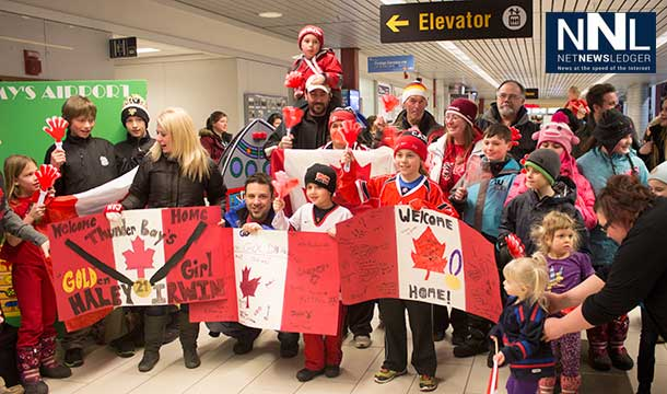 The crowd of all ages is very excited to see their hockey hero at the airport.