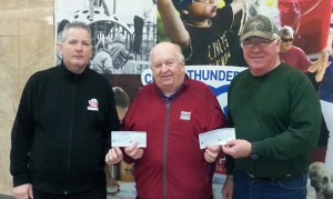 Larry Hebert, centre, President of the Thunder Bay International Baseball Association presented cheques to Ron Kowalchuk, right, President, Thunder Bay Umpires Association and Norm Randle, left, President of District 3 Little League