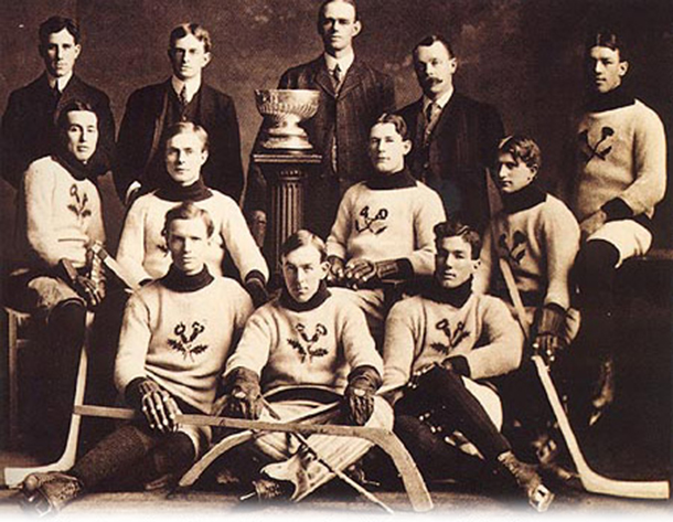 The Kenora Thistles' Stanley Cup championship photograph. Back row: team president Lowry Johnson, Russell Phillips, coach and trainer J. A. Link, and team manager Red Hudson. Middle row: Roxy Beaudro, Tom Hooper, Tommy Phillips, Billy McGimsie, and Joe Hall. Front row: Si Griffis, Eddie Giroux, and Art Ross.