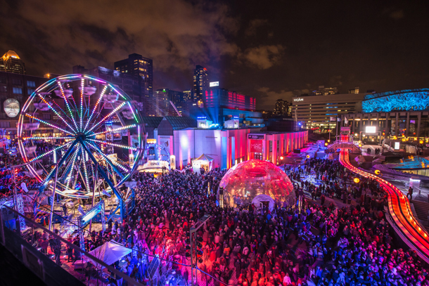 Over its 10-day run, the Montreal High Lights festival attracts hundreds of thousands of visitors to a smorgasbord of events, including a downtown festival plaza featuring everything from free art exhibits and concerts to a Ferris wheel. Photo: Montréal en Lumière/Frédérique Menard-Aubin.