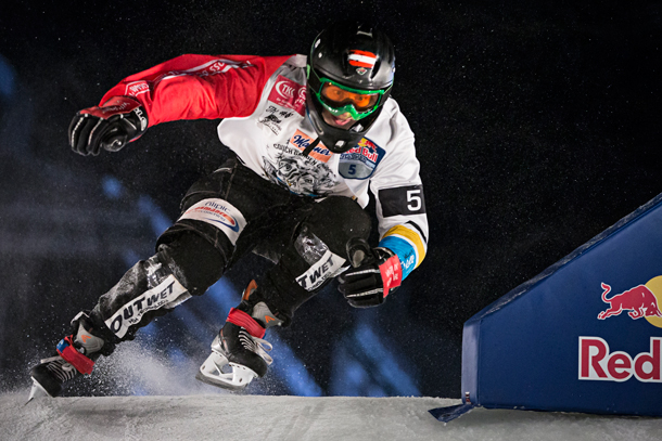 Marco Dallago of Austria performs during the finals of the Red Bull Crashed Ice, the last stop of the Ice Cross Downhill World Championship in Quebec, Canada on March 22, 2014.
