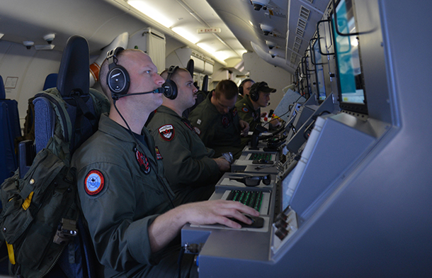 Crew members on board a P-8A Poseidon assigned to Patrol Squadron (VP) 16 man their workstations while assisting in search and rescue operations for Malaysia Airlines flight MH370. VP-16 is deployed in the U.S. 7th Fleet area of responsibility supporting security and stability in the Indo-Asia-Pacific. (U.S. Navy photo by Mass Communication Specialist 2nd Class Eric A. Pastor/Released)