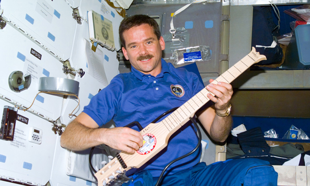 Astronaut Chris Hadfield in 1995 in space with a guitar. His love of music and teaching and engaging made his trip to the ISS historic.