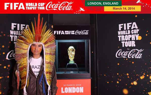 Nixiwaka Yawanawá wore a T-shirt saying 'BRAZIL: STOP DESTROYING INDIANS', but Coca-Cola and FIFA prevented him from displaying the full message while standing next to the trophy. © FIFA