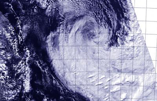 This visible image of an elongated Tropical Cyclone Ita was taken from the VIIRS instrument aboard NASA-NOAA's Suomi NPP satellite on April 15 at 3:53 UTC and shows that wind shear has blown most clouds and thunderstorms south of the center. Credit: Image Credit: NRL/NASA/NOAA