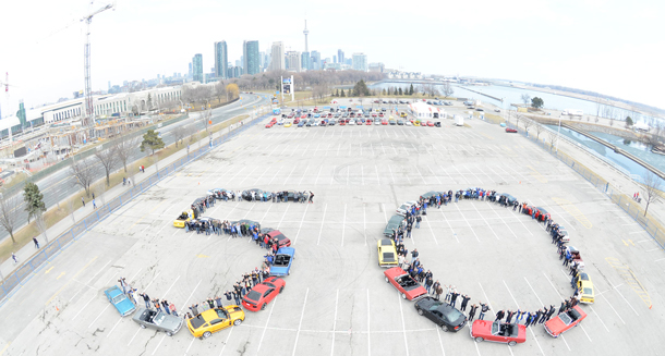 """""""50 years ago, on April 17, 1964, an automotive and pop culture icon was born. To celebrate, Ford of Canada and members of the Golden Horseshoe Mustang Association and GTA Mustang Club took an aerial shot of 25 classic Mustangs forming a '50' at Ontario Place in Toronto. Simultaneously, more than 100 additional Mustangs participated in a vintage car show at the same location. Image Ford Canada"""