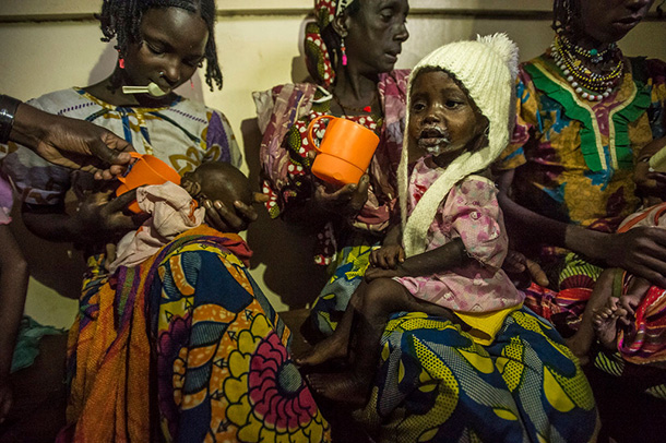 Malnourished children from Central African Republic at feeding time with their mothers in Batouri Hospital, Cameroon. Photo: UNHCR/F. Noy
