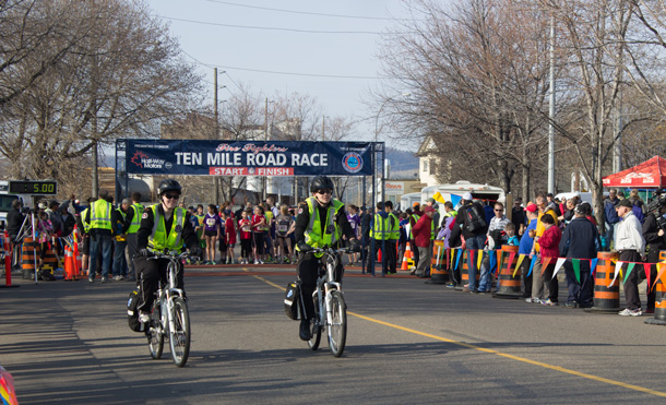 Keeping all the runners safe. St. Johns Ambulance riders follow the race.
