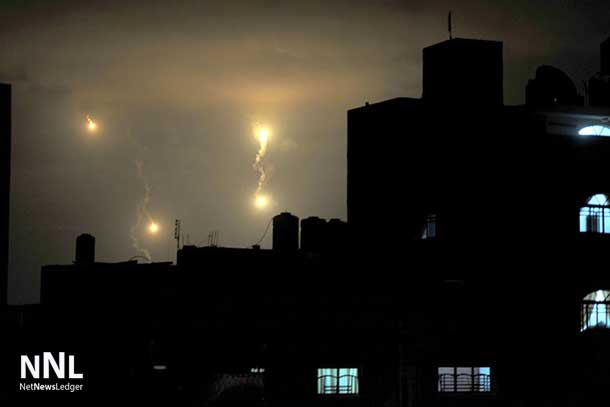 Israeli forces' flares light up the night sky of Gaza City on early Tuesday, July 29, 2014. UN Photo/Shareef Sarhan