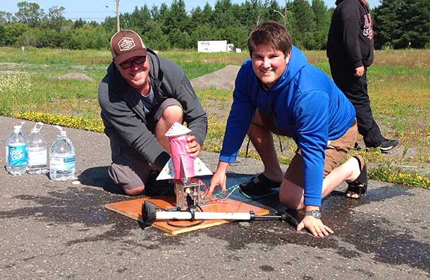 Assistant Camp Coordinator, Mark Shruiff (left) and Camp Participant, Mark Ehrenfellner Get Ready to Launch Their Homemade Bottle Rocket