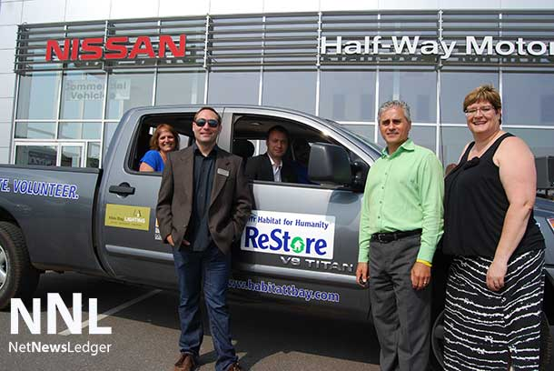 From left to right: Lucy Belanger- Equipment World, Jason Hughes- OTF Representative, Marcus Luft- Halfway Motors, Tyson Neil- Habitat for Humanity Restore (driver's seat), Bill Mauro- MPP Thunder Bay-Atikokan, Diane Mitchell - CEO Habitat for Humanity