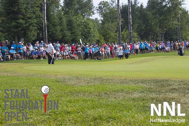 The players were followed by huge galleries of avid golf fans.