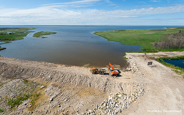 Work began today to open the Lake St. Martin Emergency Outlet Channel. Operating the channel will increase outflow from Lake St. Martin and directly lower the water level of Lake Manitoba.