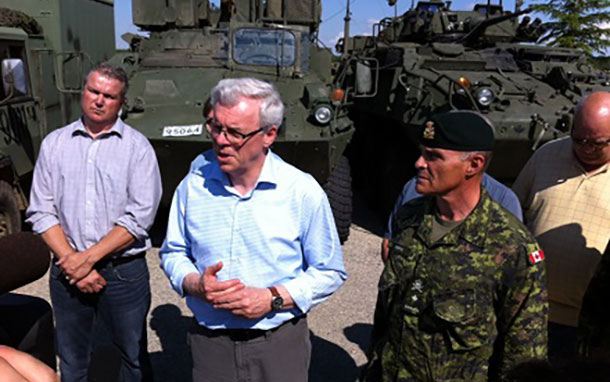 Premier Greg Selinger and Brigadier-General Christian Juneau join rural officials at Southport Airport near Portage before touring flood zones