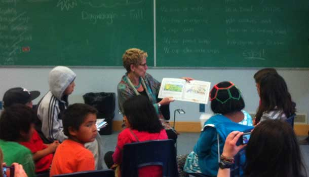 reading to kids in Marten Falls. Part of a literacy program run by Frontier College