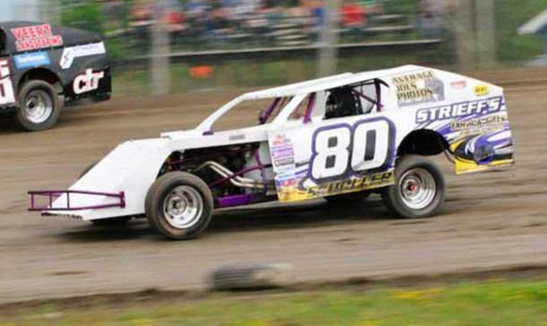 #80- Don Scholler made it back to back feature wins at two tracks in the WISSOTA Midwest Modifieds, having won at Hibbing Raceway last week, and a clean sweep at Emo Speedway on Saturday. (Photo by Kaz Graphix)