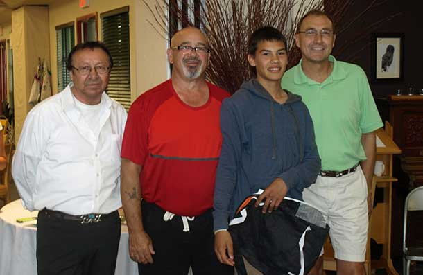 ELDER MAURICE NAVEAU has been instrumental in assisting Wabun Health staff and facilitators with traditional and cultural teachings during many years of the Wabun Youth Gathering. The gathering was held at the Eco Lodge in Elk Lake from July 14 to 25. L-R are: Elder Naveau, Mike Archer, Wabun Health; Jason Therriault, Mattagami First Nation Youth and Clayton Small, Facilitator.