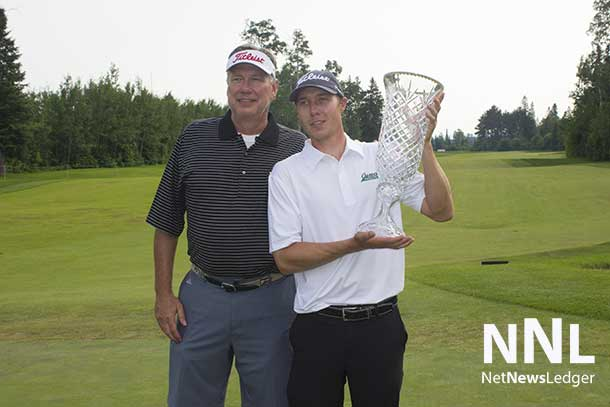 Wes Horman with his dad and the Staal Foundation Open trophy.