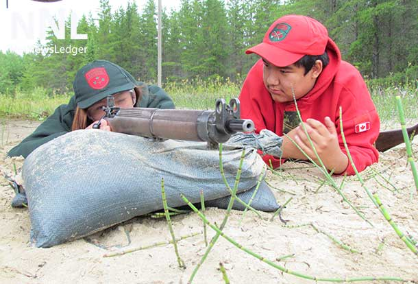Learning to shoot under the watchful eye of a Canadian Ranger