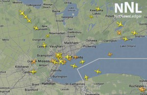 Airplanes are in a holding pattern around Toronto International Airport - July 27 2014 21:34 - Flight Tracker.