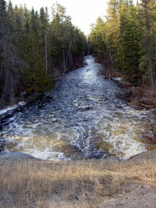 View looking downstream.  On May 10, the spring flood overflows the banks.