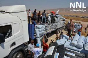 Workers unload trucks laden with hundreds of tents for families displaced by the recent fighting in Iraq. Photo: UNHCR/E. Colt