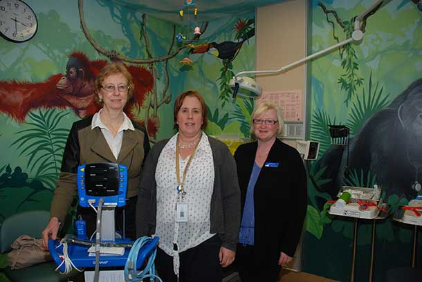 Heidi Liimatainen (right), Manager of Wealth Management and Business Development with the Provincial Alliance Credit Union, and Audrey Halvorsen (left), Vice President of Operations with the Northern Lights Credit Union were given a demonstration of how the paediatric vital signs monitor works by Christina Purdon, Manager of Paediatrics and Neonatal Intensive Care. The much needed monitor is the first piece of equipment to be purchased with income from the Thunder Bay Credit Union Endowment Fund.