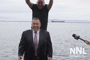 Smiling with enthusiasm as Minister Gravelle accepts the Ice Bucket Challenge for ALS