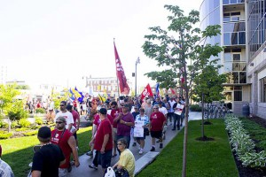 Striking Unifor Workers rally at City Hall