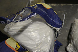 RCMP Image of white powder pulled from bag of rice