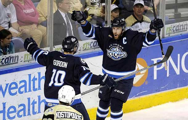 Victory: St John's IceCaps will remain in Mile One Centre for another two years. Above, Jason Jaffray, right, celebrates his goal with Andrew Gordon in the first period against the Wilkes-Barre/Scranton Penguins in game three of the AHL Eastern Conference finals in May.