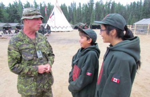 Sergeant James Doherty talks with Junior Canadian Rangers at a Junior Ranger camp.