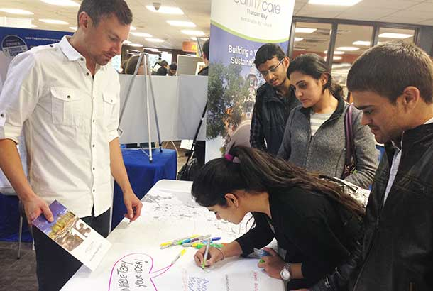 Students Share Their Sustainable Ideas for the City at the EarthCare Booth During the Student Union of Confederation College's Sustainability Fair.