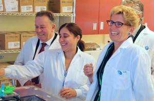 Premier Kathleen Wynne (right) with Dr. Laura Curiel (centre), Minister Michael Gravelle (left), and Minister Bill Mauro (right, partially obscured) touring the TBRRI's wet lab. This past July, the province invested a further $4 million into our growing research program.