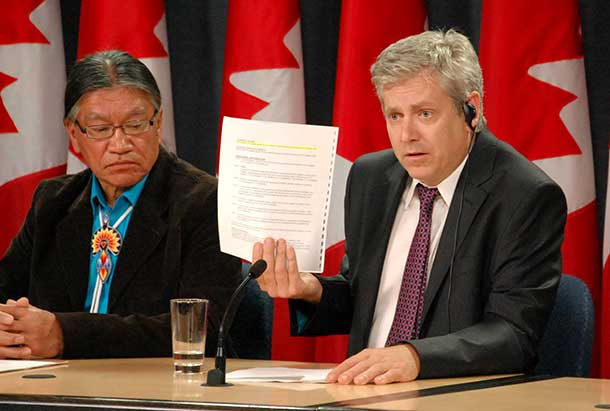 Charlie Angus with Edmund Metatawabin holding up the false evidence narrative supplied by the Justice Department for the IAP hearings.