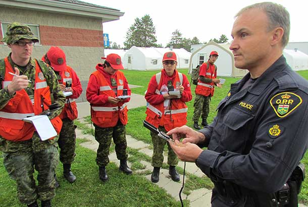 OPP Constable John Meaker teaches search and rescue techniques to Canadian Rangers - Photo by Sergeant Peter Moon, Canadian Rangers
