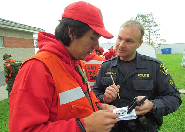 OPP Constable John Meaker reviews the use of a compass with Ranger Sinclair Childforever of Fort Severn