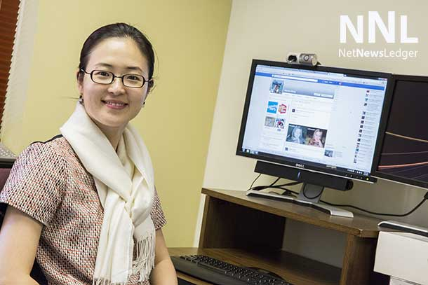 Associate Professor  Song is researching the impact of Facebook on social interaction in North America.