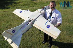 NASA researcher Mike Logan plans to use this small unmanned aerial vehicle to check for fires at a Virginia-North Carolina wildlife refuge as part of an agreement with the U.S. Fish and Wildlife Service Image Credit: NASA Langley/David C. Bowman