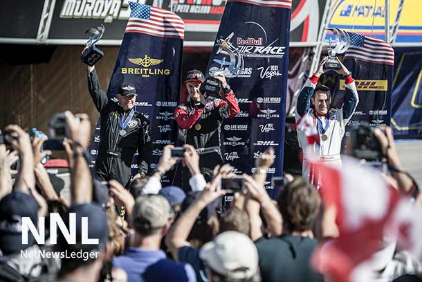 Nigel Lamb of Great Britain (L), Pete McLeod of Canada (C) and Matthias Dolderer (R) celebrate during the Award Ceremony on the seventh stage of the Red Bull Air Race World Championship at the Las Vegas Motor Speedway in Las Vegas, Nevada, United States on October 12, 2014. - Predrag Vuckovic/Red Bull Content Pool