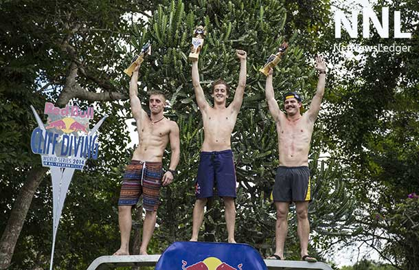 Second placed Artem Silchenko (L) of Russia, event and 2014 World Series winner Gary Hunt (C) of the UK, and third placed David Colturi (R) of the USA celebrate with their trophies during the seventh and final stop of the Red Bull Cliff Diving World Series, Ik Kil cenote, Yucatan, Mexico on October 18th 2014. Photographer: Romina Amato
