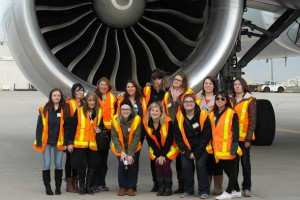 Confederation College's ACTA delegates pose with an Air Canada 320 Airbus during their airside tour of Toronto Pearson International Airport.
