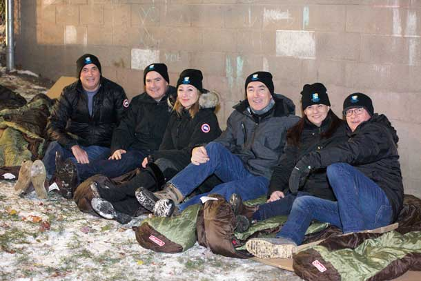 Bedding down for homeless youth at Covenant House Toronto's Executive Sleep Out are (l to r) Duncan Hannay, president, Davis & Henderson Ltd., Cineplex Entertainment COO Dan McGrath, The Stronach Group Chairman and President Belinda Stronach, Purolator President Patrick Nangle, TAXI Canada President Nancy Beattie, and Covenant House's Bruce Rivers.